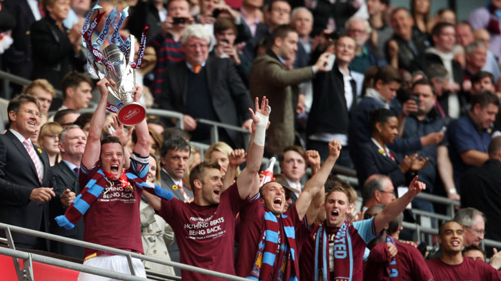 Noble and Collison celebrate winning promotion in 2012