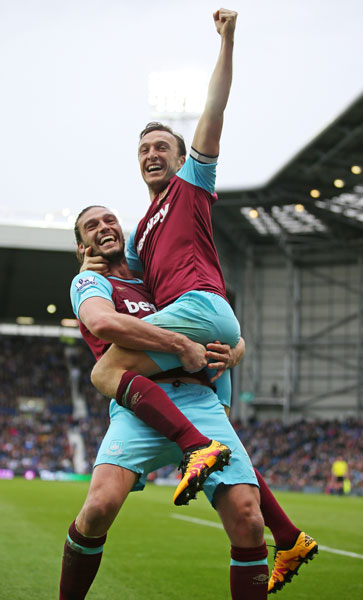 Andy Carroll celebrates a goal with Mark Noble at West Bromwich Albion