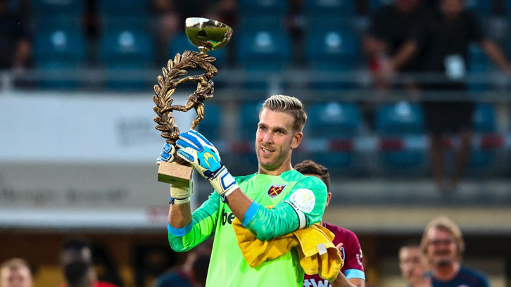 Adrian lifts the Betway Cup following victory over Mainz in Austria