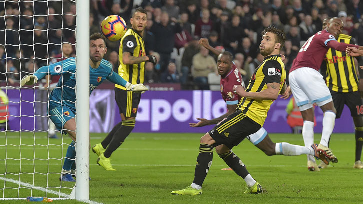 Michail Antonio sees his header hit the Watford post