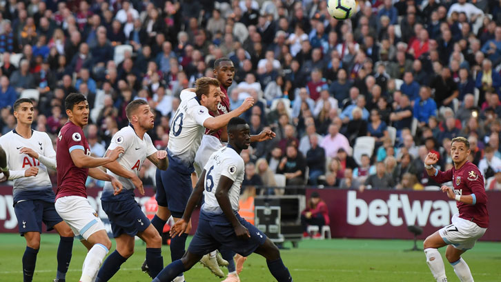 Issa Diop rises above the Tottenham defence during Saturday's game