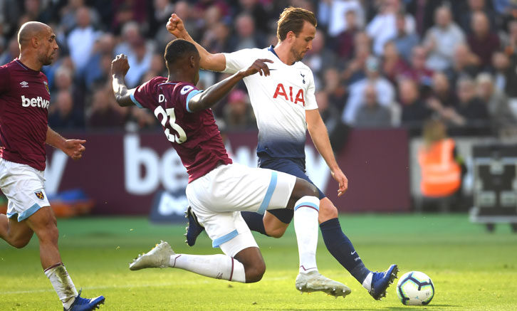 Issa Diop blocks a shot from Harry Kane