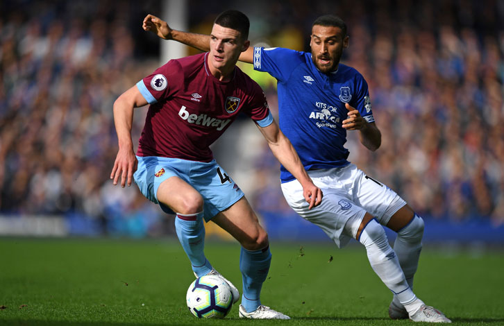 Declan Rice gets away from Everton striker Cenk Tosun