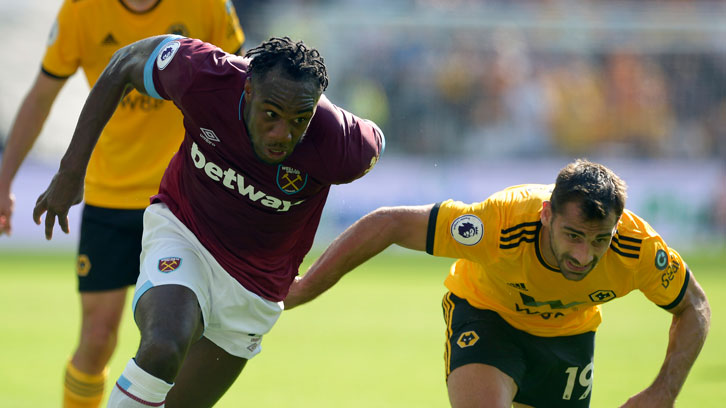 Michail Antonio battles for possession against Wolverhampton Wanderers