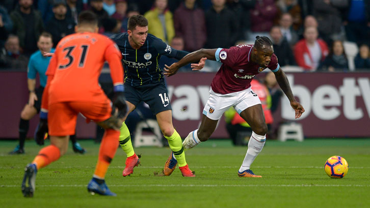 Michail Antonio in action against Manchester City