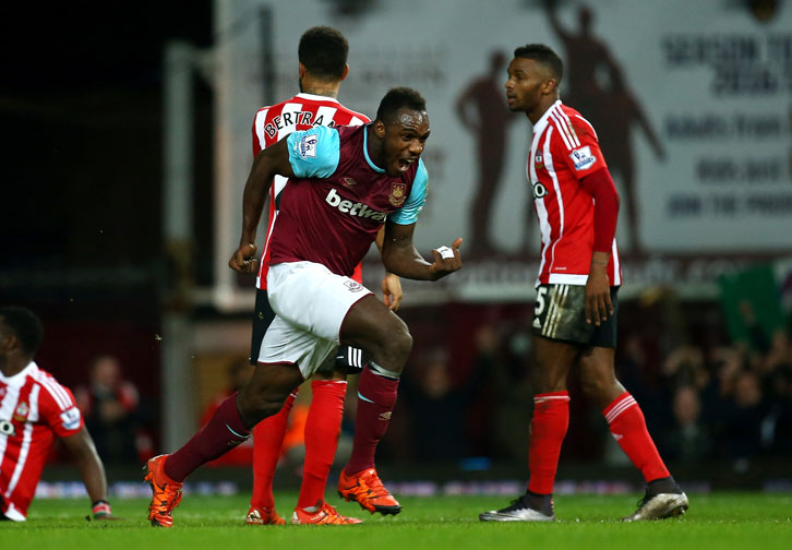 Michail Antonio celebrates scoring against Southampton in December 2015