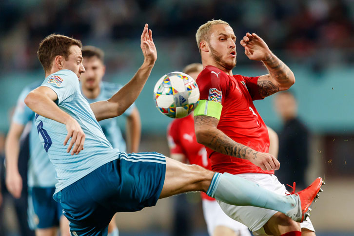 Marko Arnautovic is challenged by Jonny Evans