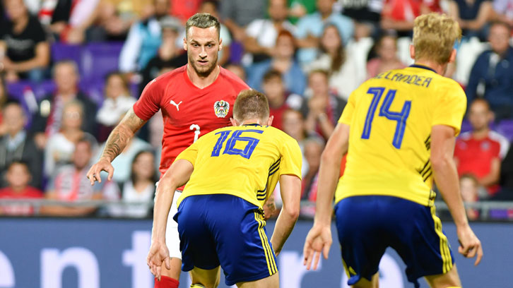 Marko Arnautovic takes on the Sweden defence