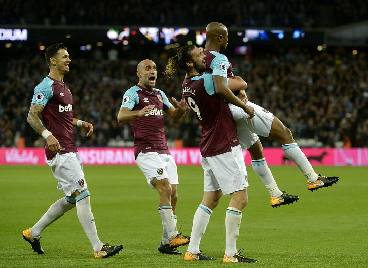 Andre Ayew celebrates scoring against Huddersfield Town
