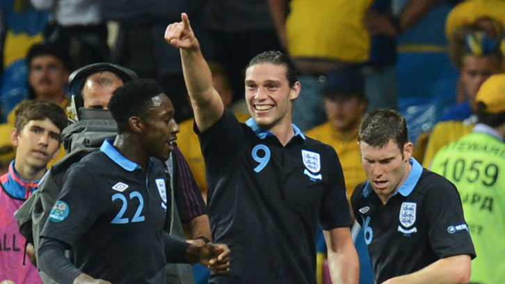 Andy Carroll celebrates scoring against Sweden