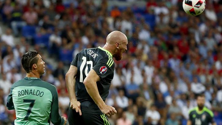 James Collins heads clear ahead of Cristiano Ronaldo