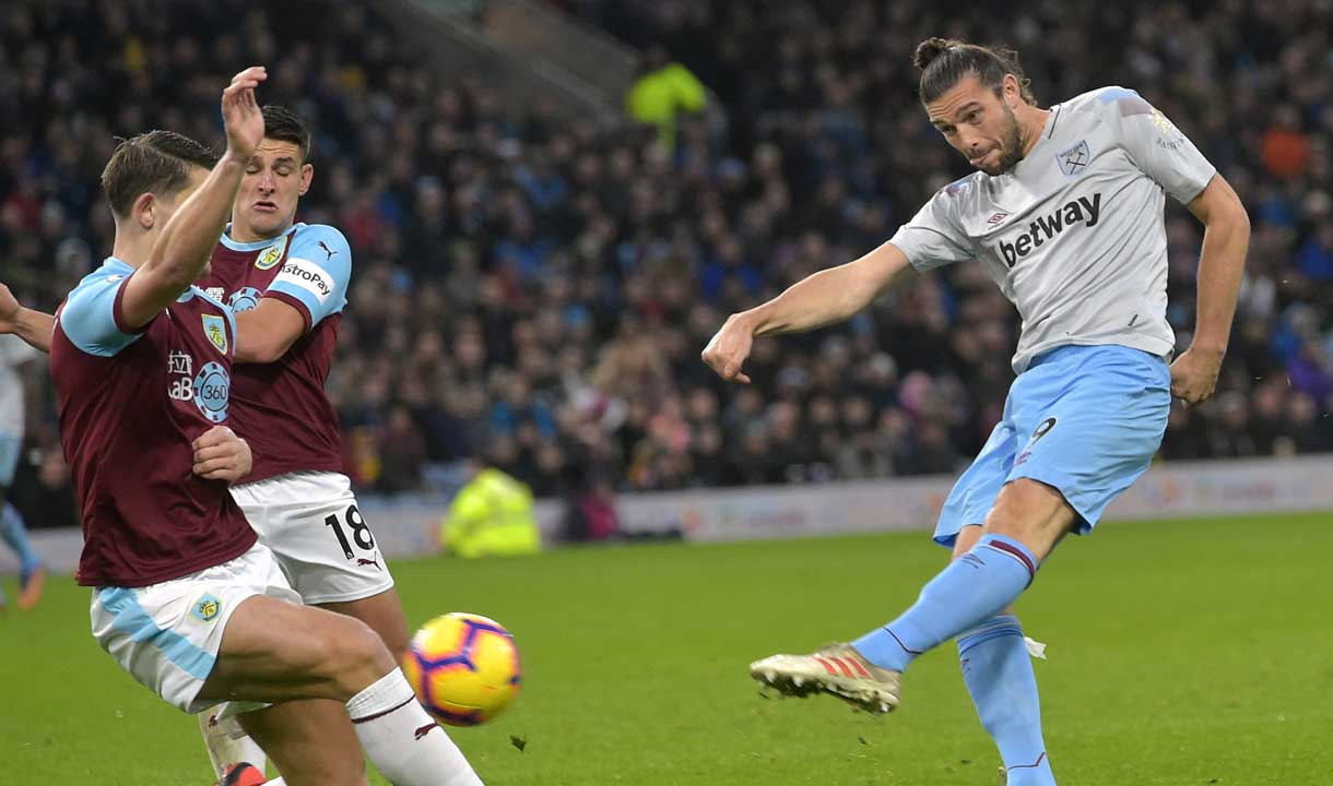 Andy Carroll fires in a shot at Burnley