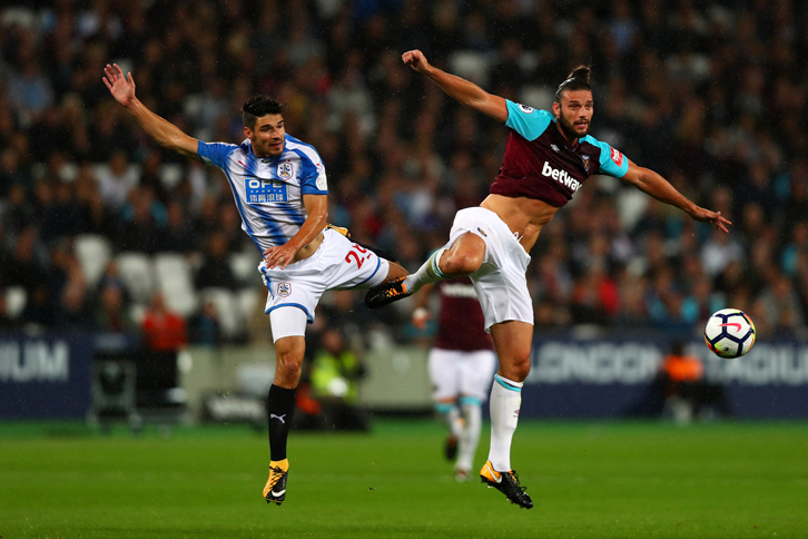 Andy Carroll in action against Huddersfield