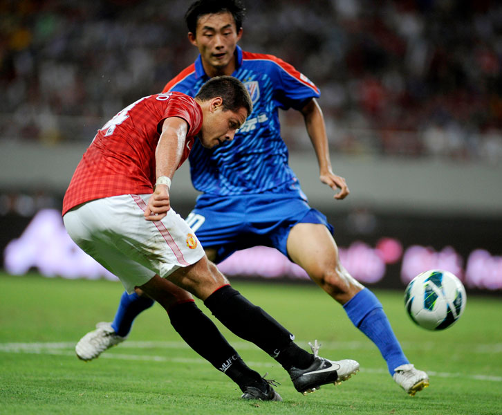 Chicharito in action for Manchester United against Shanghai Shenhua in July 2012