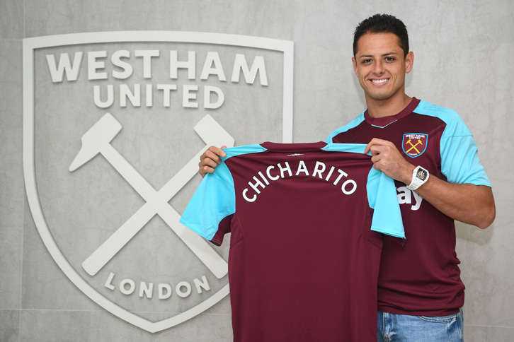 Javier Hernandez poses with the West Ham shirt