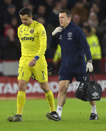 Richard Collinge tends to Lukasz Fabianski