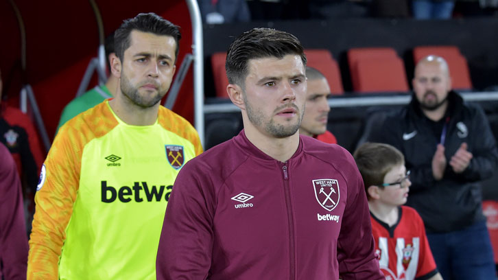 Aaron Cresswell leads West Ham United out to face Southampton