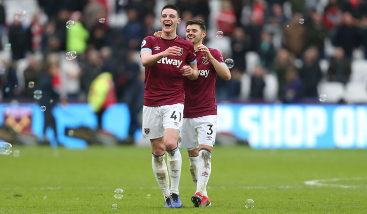 Aaron Cresswell with Declan Rice