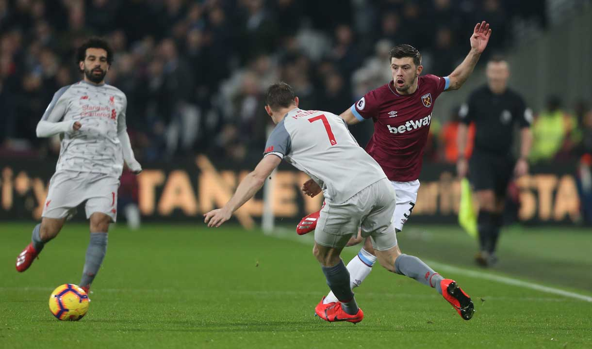Aaron Cresswell takes on James Milner