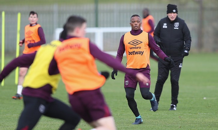 Patrice Evra trains under the guidance of manager David Moyes