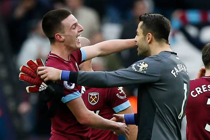 Lukasz Fabianski celebrates with Declan Rice