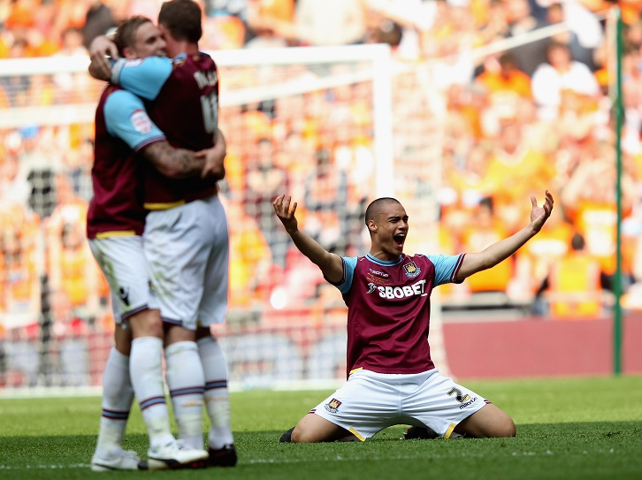 Winston Reid celebrates winning promotion at Wembley in 2012