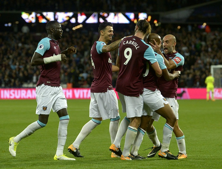 Andre Ayew celebrates after scoring West Ham United's second goal against Huddersfield Town