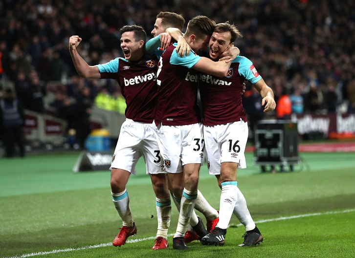 Reece Burke celebrates his winning goal with Mark Noble