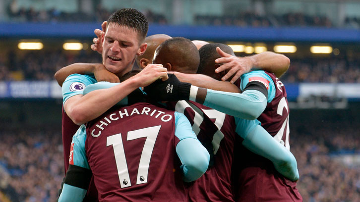 Chicharito is mobbed by his teammates after equalising at Stamford Bridge