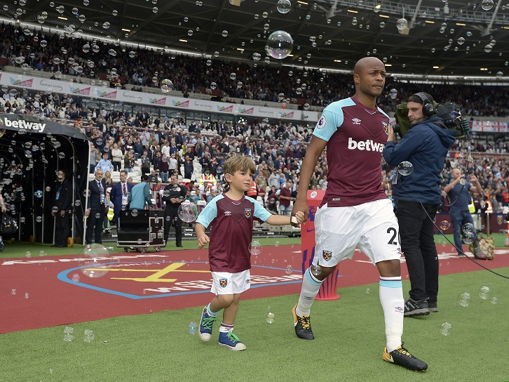 Duarte Buzio takes to the pitch with Andre Ayew