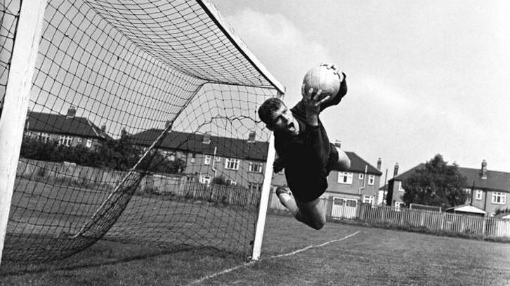 Lawrie Leslie makes a flying save at Chadwell Heath