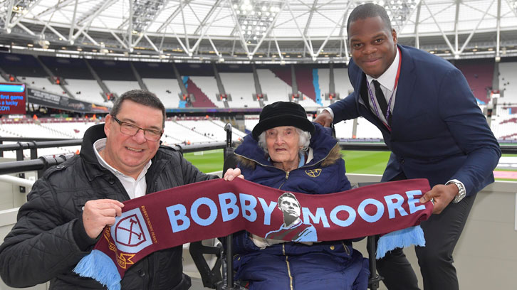 Mabel Arnold with her son Graham and Marlon Harewood at London Stadium