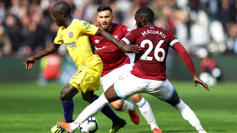 Arthur Masuaku makes a challenge against Chelsea