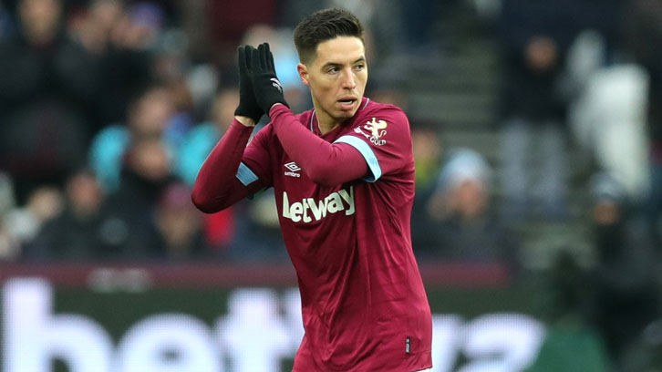 Samir Nasri applauds the Claret and Blue Army on his way off the pitch