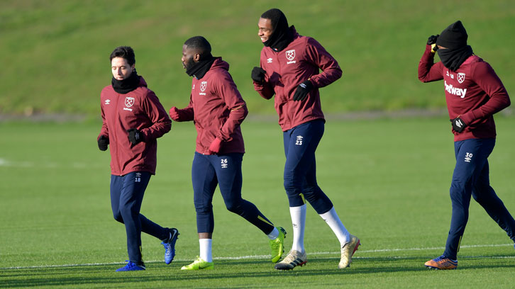 Issa Diop (left) trains with Samir Nasri and Arthur Masuaku at Rush Green
