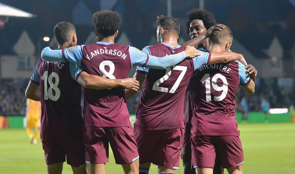 The Hammers celebrate Jack Wilshere's goal at Newport