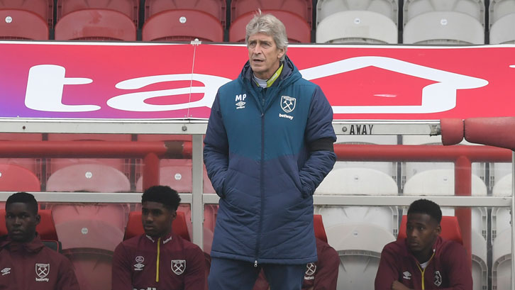 Manuel Pellegrini watches on at Griffin Park