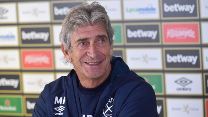 Manuel Pellegrini smiles during his pre-Everton press conference