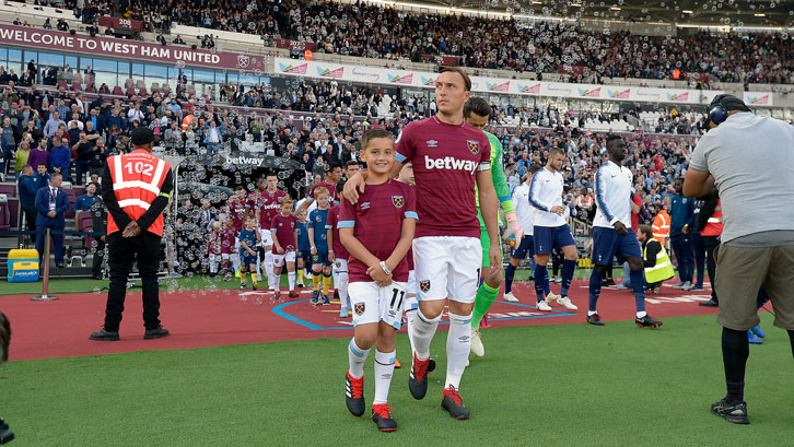 Ralphy Orsini and Mark Noble lead out the Hammers at London Stadium
