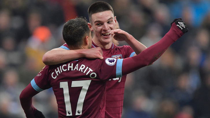 Declan Rice celebrates with Chicharito at Newcastle