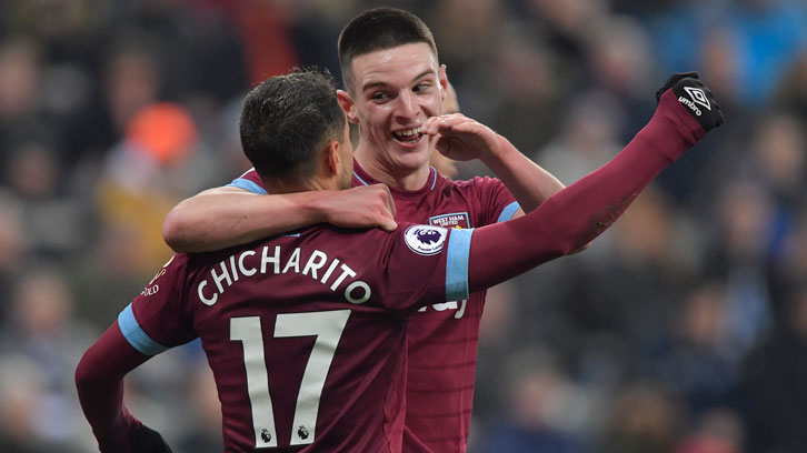 Declan Rice celebrates with Chicharito at St James' Park