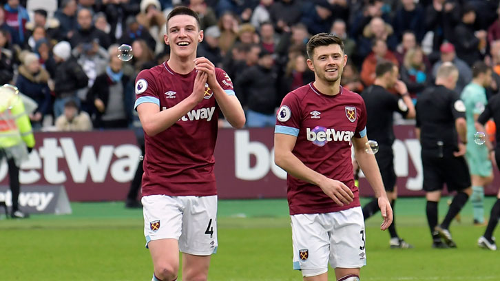 Declan Rice and Aaron Cresswell applaud the Claret and Blue Army