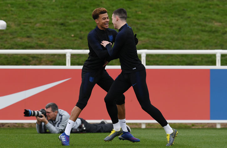 Declan Rice trains alongside Tottenham Hotspur's Dele Alli