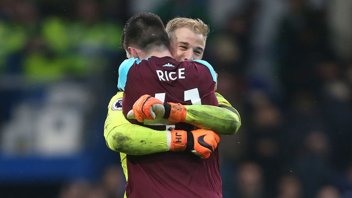 Declan Rice and Joe Hart celebrate a hard-earned point at Chelsea