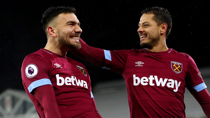 Robert Snodgrass and Chicharito celebrate at Fulham