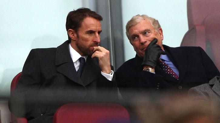 Gareth Southgate chats to Sir Trevor Brooking at London Stadium
