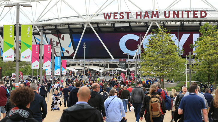 Supporters approach London Stadium on a matchday