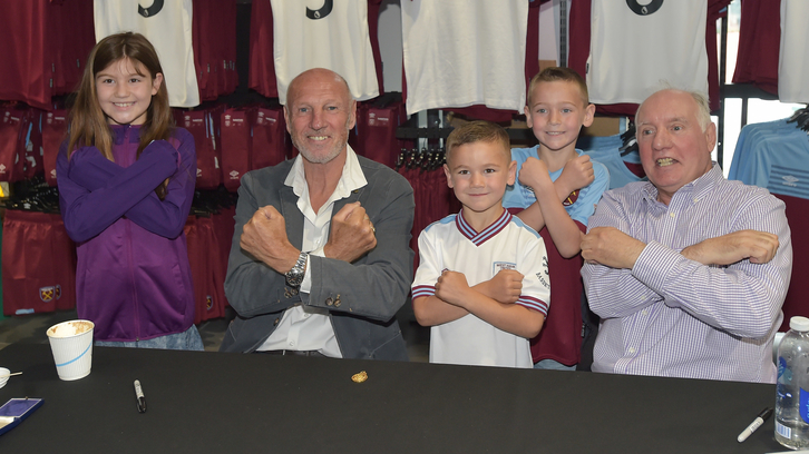 Alvin and Alan pose with three young West Ham fans