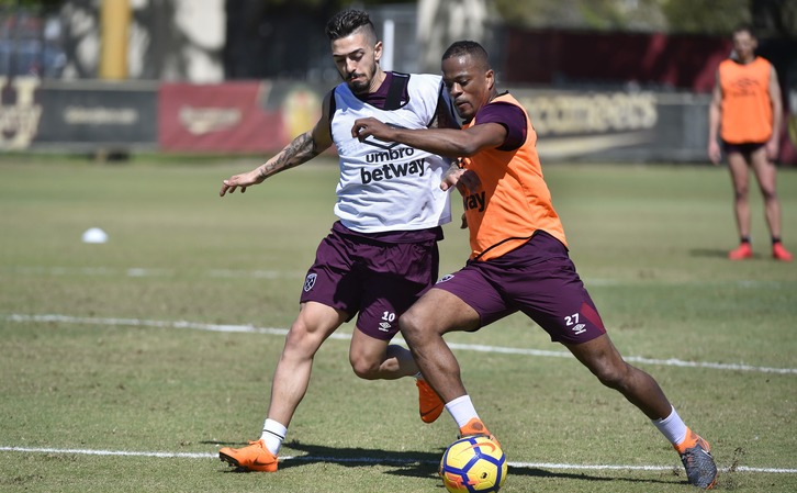 Patrice Evra trains with Manuel Lanzini