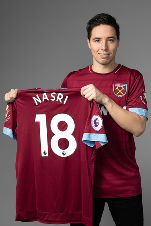 Nasri poses with his shirt